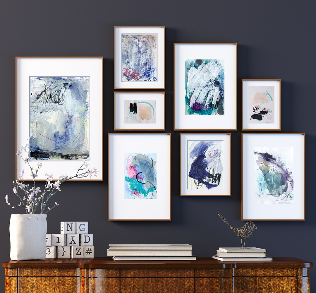Gallery wall blue abstract paintings